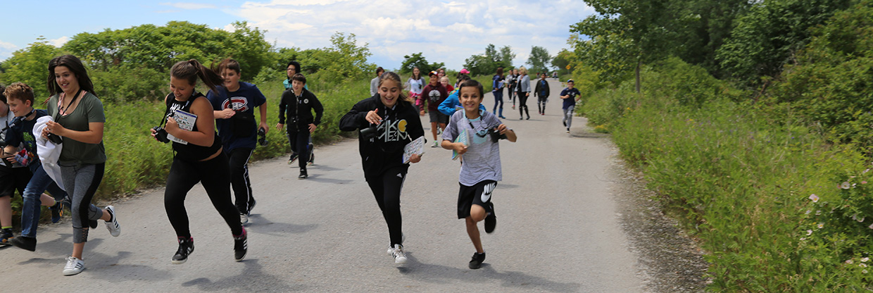 youngsters run on trail at Tommy Thompson Park