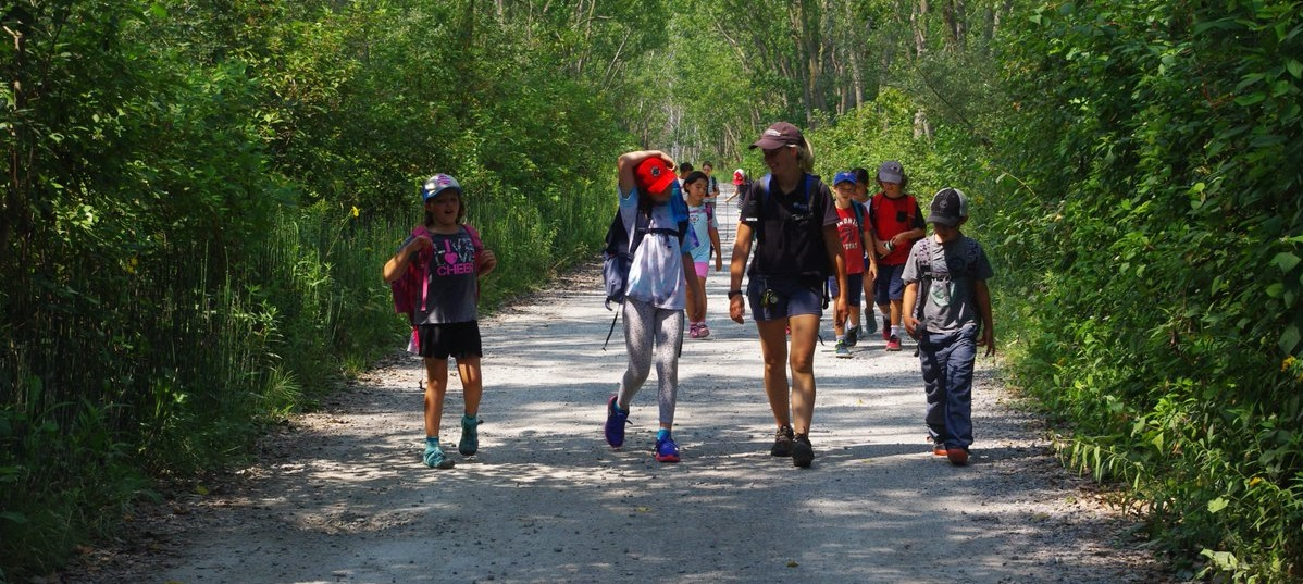 campers and counselor explore Tommy Thompson Park trail during Nature Camps on the Spit